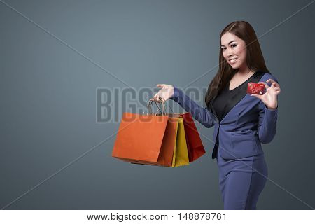 Young Beautiful Asian Woman Holding Shopping Bags And Show Her Credit Card