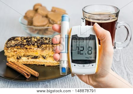 Diabetes And Unhealthy Eating Concept. Hand Holds Glucometer And