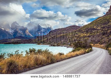 Chile, Patagonia. Torres del Paine National Park - Biosphere Reserve. Concept of ecotourism. The road around the lake Pehoe
