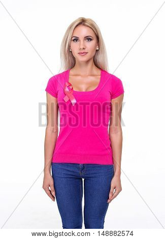 healthcare and medicine concept - smiling beautiful blonde woman in pink t-shirt with pink breast cancer awareness ribbon on the white background.