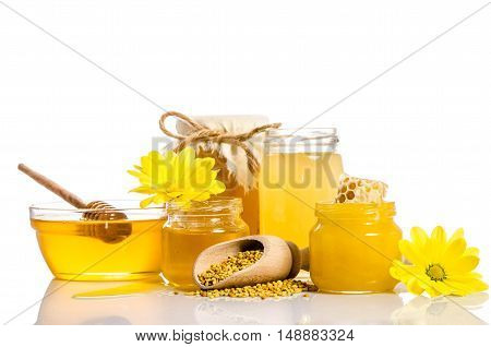 The Bank Of Honey With Honeycombs, Glass Bowl With Honey And Wooden Scoop With Pollen