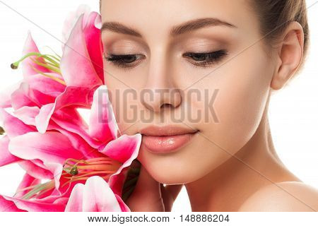 Portrait Of Young Beautiful Caucasian Woman With Pink Lilies