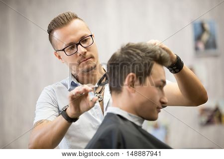 Male Hairdresser Making Haircut