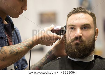 Bearded Man Getting Haircut In Barbershop
