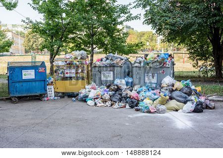 Lviv Ukraine - September 13 2016: Dumpsters being full with garbage
