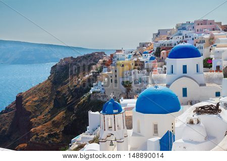 Oia, traditional greek village of Santorini with blue domes of churches, Greece
