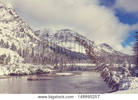 Early winter with first snow covering rocks and woods in the Glacier National Park, Montana, USA