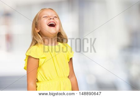 Very happy laughing child. Bright blurred background