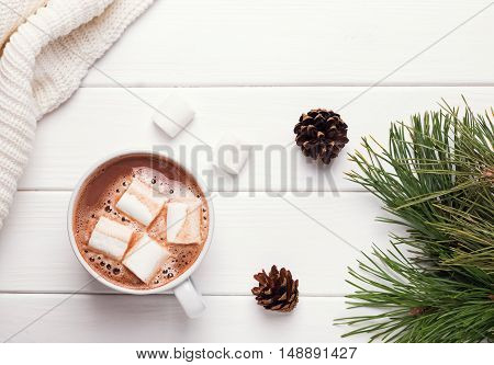 Hot cocoa with marshmallows on white table top view
