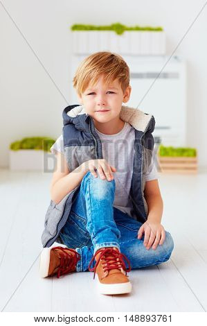 Portrait Of Cute Fashionable Kid, Boy Sitting On The Floor
