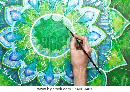Man Painting Bright Green Picture With Circle Pattern, Mandala Of Anahata Chakra