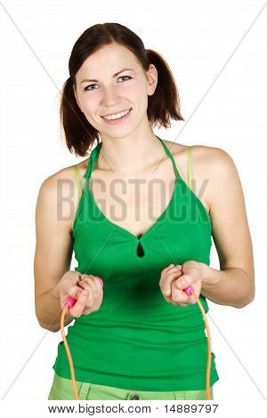Young Girl In Green Shirt With Skipping Rope, Smiling And Looking At Camera, Isolated