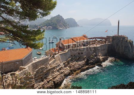 the restaurant on the cliff romantic sea and rocky coasta wonderful holidayhorizon underwater rocks and vegetation on the rocks flora and fauna
