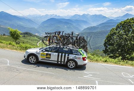 Col D'AspinFrance- July 152015: Technical car of MTN-Qhubeka Team driving on the road to Col D'Aspin in Pyrenees Mountains during the stage 11 of Le Tour de France 2015.