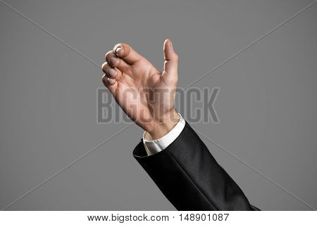Business Man's Hand To Hold Card, Mobile Phone Or Other Palm Gadget. Isolated On Gray Background.