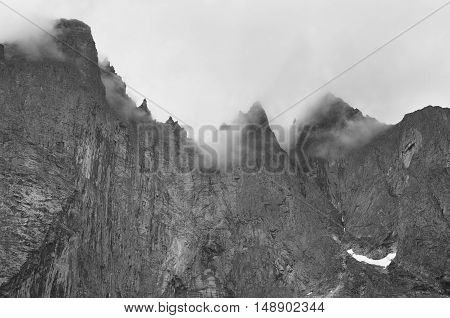 Norway landscape. Troll wall massif mountain Trollveggen. Romsdalen valley. Cloudy