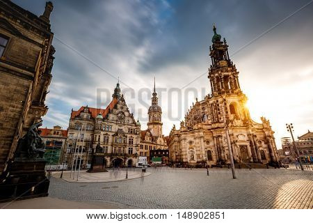 Dramatic view of cathedral Catholic Hofkirche and palace Georgenbau at old town. Historical scene, tourist attraction. Location place Dresden, Saxony, Germany, Europe. Beauty world.