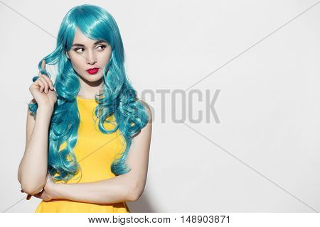Pop art woman portrait wearing blue curly wig and bright yellow dress. White background. Space for text.