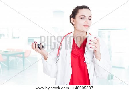 Beautiful Female Doctor Relaxing With Coffee