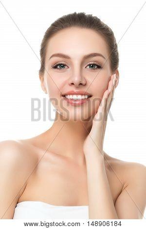 Portrait Of Young Beautiful Caucasian Woman Touching Her Face