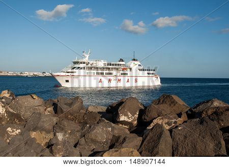 LANZAROTE, SPAIN - SEPTEMBER 9, 2015: Canary Island Ferry Sails from Playa Blanca Lanzarote and Corralejo Fuerteventura