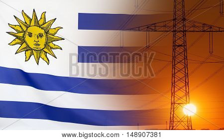 Concept Energy Distribution Flag of Uruguay with high voltage power pole during sunset