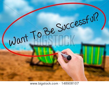 Man Hand Writing Want To Be Successful?  With Black Marker On Visual Screen