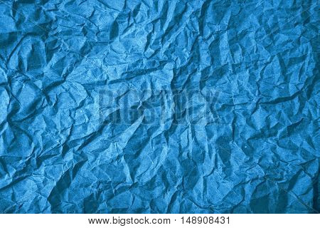 Rough blue crumpled paper texture as background for graphic design
