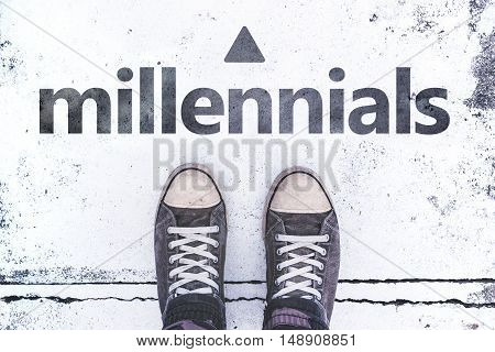 Millennials concept with pair of sneakers on the pavement casual young generation lifestyle
