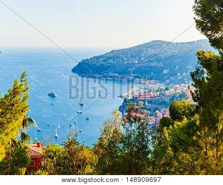 Charming Blue Bay with a lot of yachts and boats anchored on the Cote d'Azur in Villefranche-sur-Mer, France.