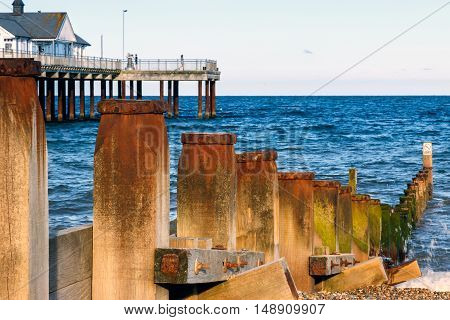 Wooden Groynes And Pier At Southwold Beach, Uk