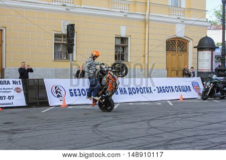 St. Petersburg, Russia - 12 August, Biker showing driving skills,12 August, 2016. The annual International Festival of Motor Harley Davidson in St. Petersburg Ostrovsky Square.