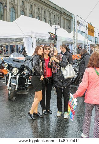 St. Petersburg, Russia - 12 August, A group of women making selfie,12 August, 2016. The annual International Festival of Motor Harley Davidson in St. Petersburg Ostrovsky Square.