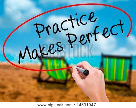 Man Hand Writing Practice Makes Perfect With Black Marker On Visual Screen
