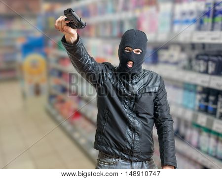 Robbery In Store. Robber Is Threatening And Aiming With Pistol I