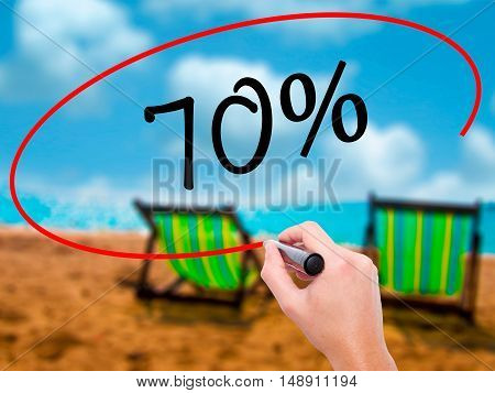 Man Hand Writing 70% With Black Marker On Visual Screen