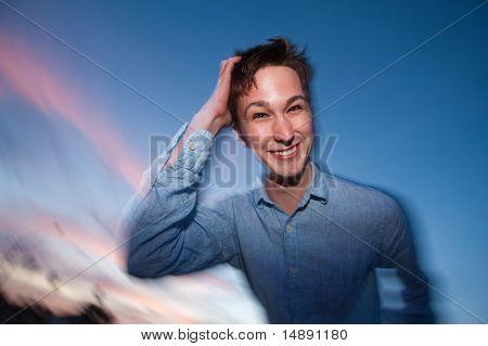 Man Scratches His Head