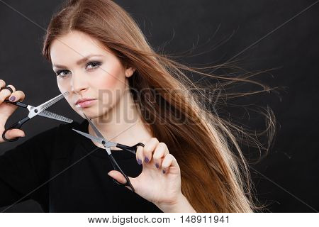 Female Hairstylist Barber With Scissors.