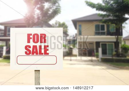 Beautiful business new house real estate sign in front of new house for sale