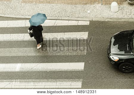 Weather nature atmosphere protection relax concept. Person with umbrella. Someone walking in rain covering himself from water.