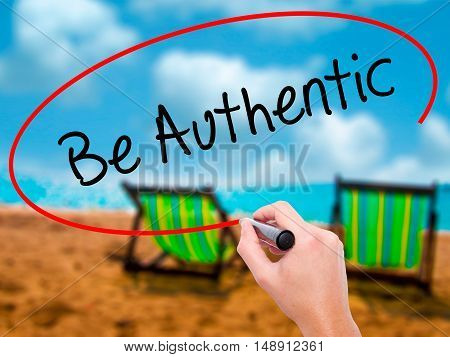 Man Hand Writing Be Authentic With Black Marker On Visual Screen