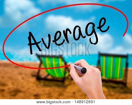 Man Hand Writing Average With Black Marker On Visual Screen