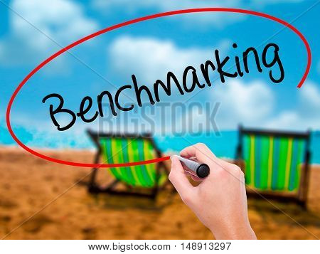 Man Hand Writing Benchmarking  With Black Marker On Visual Screen