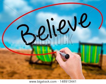 Man Hand Writing Believe With Black Marker On Visual Screen