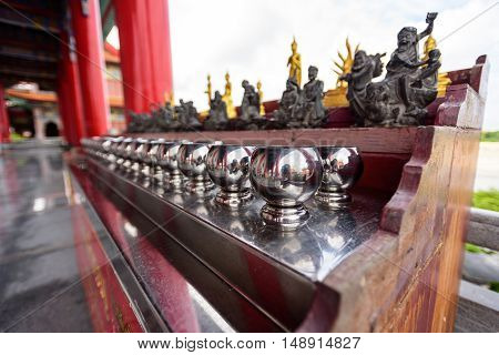 NonTaburi,Thailand - Sep 25 , 2016 : Silver monk's alms bowl and statue in Dragon Temple Kammalawat Temple