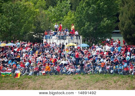Spectators on grass on The Formula 1 Grand Prix