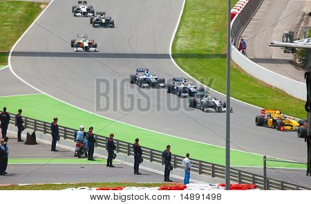 "Racing cars on a circuit during The Formula 1 Grand Prix at autodrome ""Catalunya Montmello"""