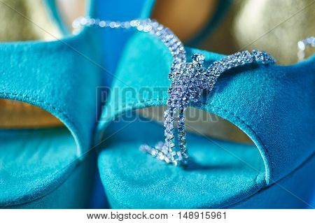 Bride attributes. Morning of the bride. Wedding accessories and turquoise shoes. Preparations for the wedding ceremony