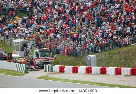"The racing car take off from line in sandy zone during The Formula 1 Grand Prix at autodrome ""Catalu"