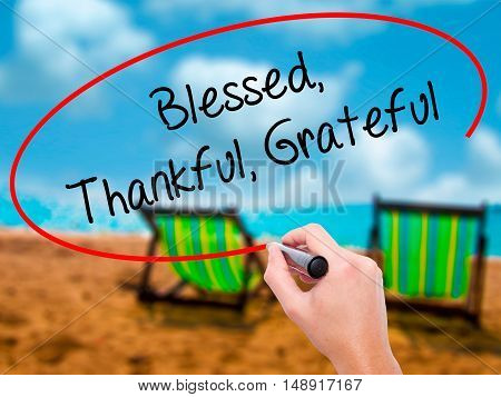 Man Hand Writing  Blessed Thankful Grateful With Black Marker On Visual Screen